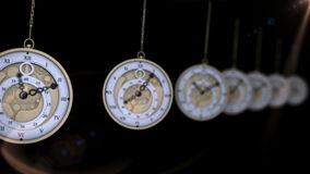 Hanging pocket watches ticking in a row stock video footage