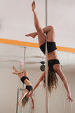 Hanging on the pole. Woman training pole dance, hanging upside down Stock Images