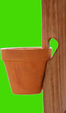 Hanging Pot. Close up of terracotta pot in wooden plant hanger royalty free stock photo