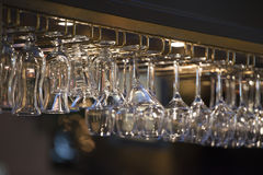 Hanging pub glasses Royalty Free Stock Images