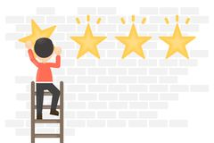Hanging rating stars. Man on ladder hang golden star on the wall Royalty Free Stock Image