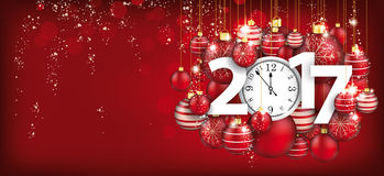 Hanging Red Baubles Christmas Clock 2017 Header. Red christmas card with hanging red baubles, clock and date 2017 Stock Image
