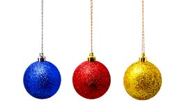 Hanging red blue and yellow christmas ball isolated on a white Stock Photography