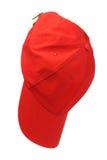 Hanging Red Cap. Red Baseball Cap Hanging on White Background Stock Photo