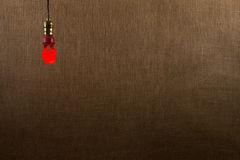 Hanging Red CFL Bulb Background Royalty Free Stock Image