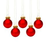 Hanging red Christmas ornaments isolated. Group of hanging red Christmas ornaments with ribbon isolated on white Stock Images