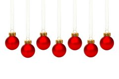 Hanging red Christmas ornaments isolated Royalty Free Stock Photography