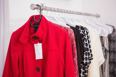 Hanging red coat Stock Photos