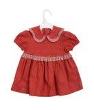 Hanging red dress girl Stock Photos