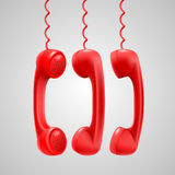 Hanging red handsets Stock Photo