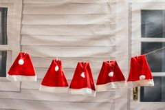 Hanging red hat prepare for Christmas and Happy new year. Santa red hat prepare ready for Christmas eve and Happy new year.  Holiday season symbol Royalty Free Stock Photo