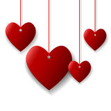 Hanging red hearts. Blank hanging red hearts on white background Royalty Free Stock Photo