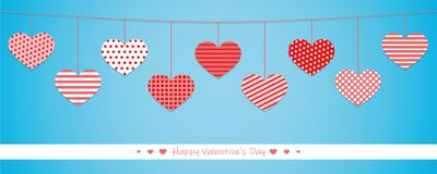 Hanging red hearts with different pattern on blue background for royalty free illustration