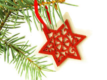 Hanging red star on Christmas tree Stock Images