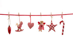 Hanging red white checked christmas decoration isolated on the b Stock Photo