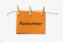 Hanging remember note. Reminder note with a text. could be used to resembel facebook or blog post royalty free stock photo