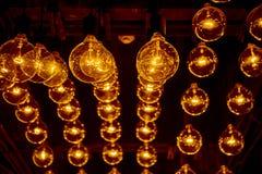 Hanging retro light bulbs. Hanging retro warm light bulbs royalty free stock image