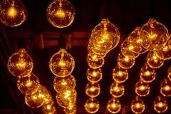 Hanging retro light bulbs. Hanging retro warm light bulbs stock photos