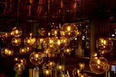 Hanging retro light bulbs. Hanging retro warm light bulbs royalty free stock photos