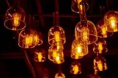 Hanging retro light bulbs. Hanging retro warm light bulbs stock photography
