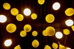 Hanging retro light bulbs. Hanging retro warm light bulbs stock photo