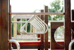 Hanging rings of play equipment with playground : Closeup. Hanging rings of play equipment with playground : Close up Stock Photos