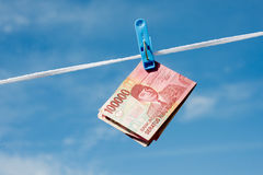 Hanging on the rope Indonesian banknotes rupiah Stock Photography