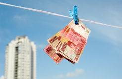 Hanging on the rope Indonesian banknotes rupiah Royalty Free Stock Photos