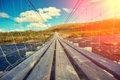 hanging rope wooden bridge in Norway stock images