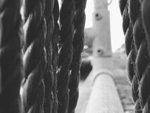 Hanging ropes on harbour steel railings Royalty Free Stock Photography