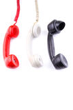 Hanging rotary telephone hand sets Stock Photos