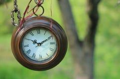 Hanging round clocks outdoor Stock Photos