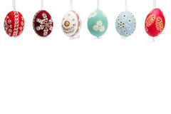Hanging row of hand painted easter eggs Stock Image