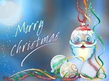Hanging Santa Clause Christmas ball. Santa Clause ball bearing with streamers and tinsel Stock Photo