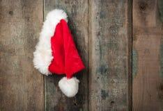 Hanging Santa hat on barn wall Royalty Free Stock Photos