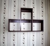 Hanging shelves on the wall. Stock Photo