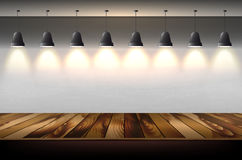 Hanging shining lamps with wall background and wooden floor Royalty Free Stock Photo