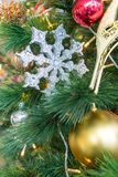 Hanging shiny silver Christmas wreath with tinsel and ornaments Stock Photography