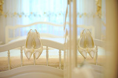 Hanging Shoes on Bed Royalty Free Stock Photography