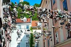 Hanging shoes, Ljubljana Stock Photography