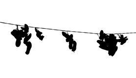 Hanging shoes silhuette Stock Images