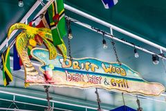 Hanging sign at Driftwood Boat Bar and Grill on Maho Beach in Simpson Bay, Sint Maarten royalty free stock photo