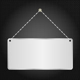 Hanging sign. Panel on black background Royalty Free Stock Image
