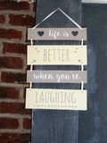 Life is better when you`re laughing sign. A hanging sign saying Life is better when you`re laughing royalty free stock images