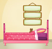 Hanging signboards inside a room with a pink bed Stock Photo