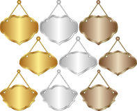 Hanging signs. Set of isolated hanging signs - gold, silver, brown Stock Images