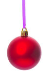 Hanging single red christmas ball isolated on white background Royalty Free Stock Image