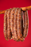 Hanging smoked domestic trditional sausage Stock Photo