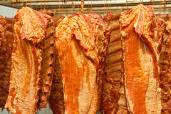 Hanging smoked pork ribs Royalty Free Stock Photos