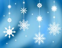 Hanging Snowflake Ornaments Background. A background illustration featuring hanging snowflake ornaments against a blue gradient soft background Stock Photos